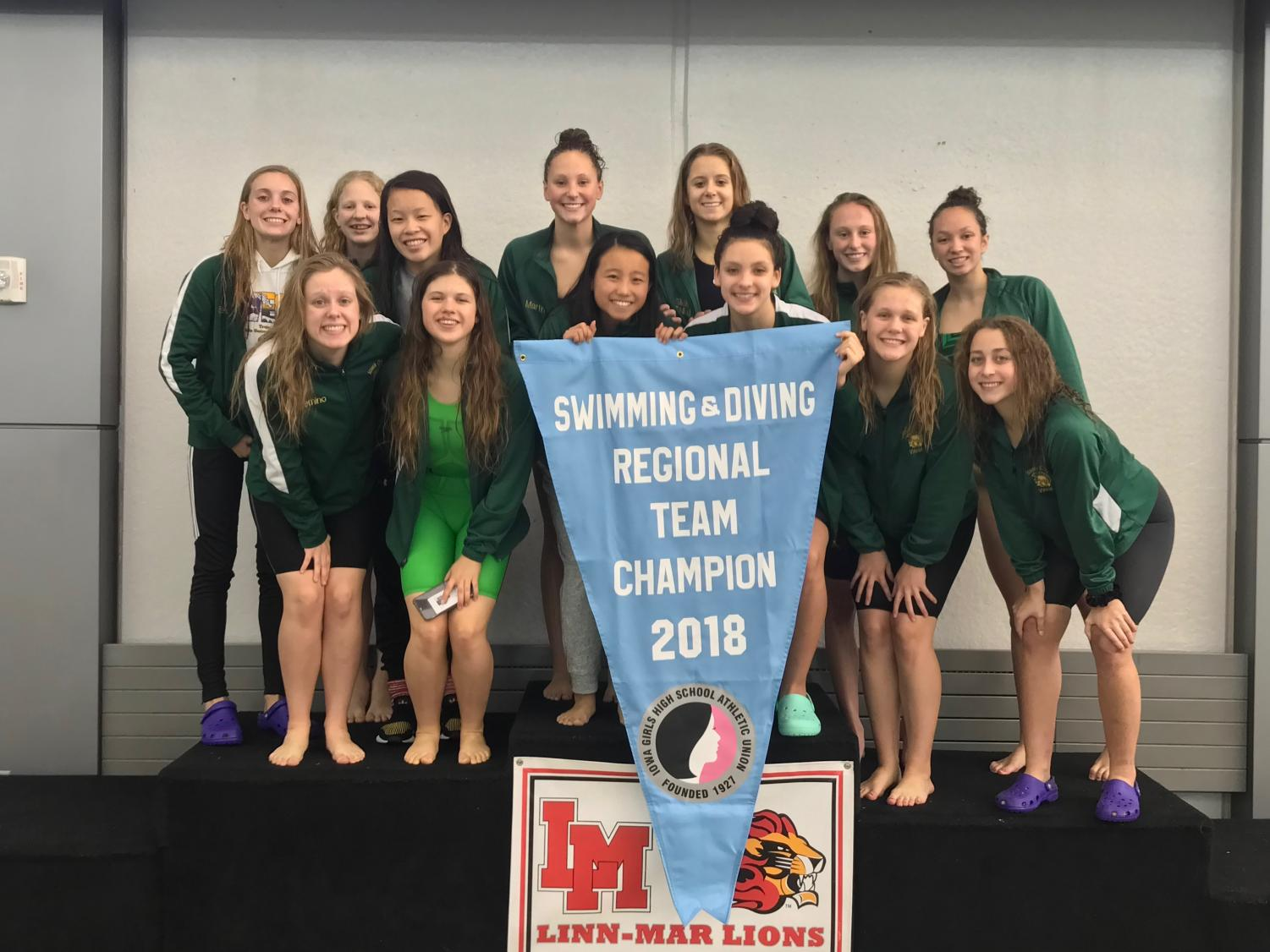 West's girls swimming team poses after winning regionals on October 27