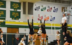 Rylee Fay '20 and Emily Cray '19 jump to block a Kennedy hitter on Wednesday, Oct. 17.