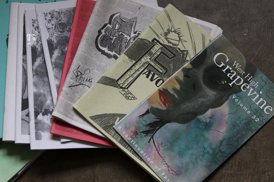 A stack of Grapevine's, West High's literary magazine, is scattered across the floor.