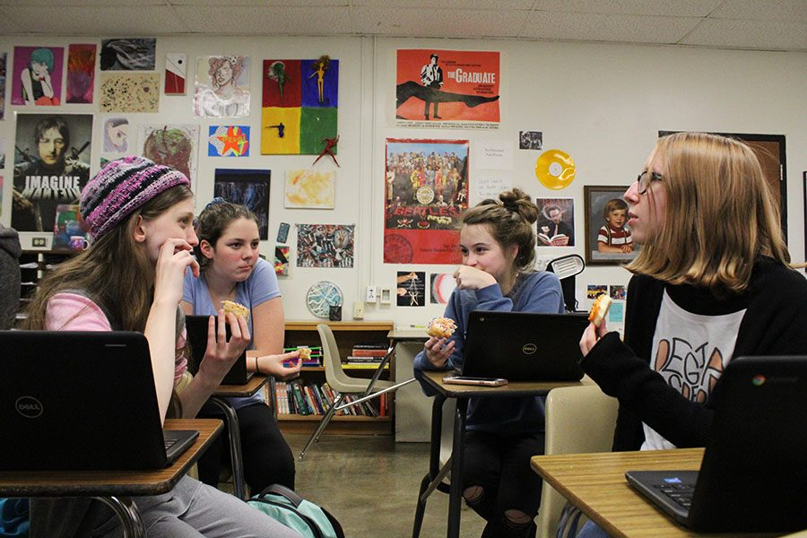 Film Club members discuss ideas for their upcoming film at their weekly club meeting on Friday, Nov. 9.