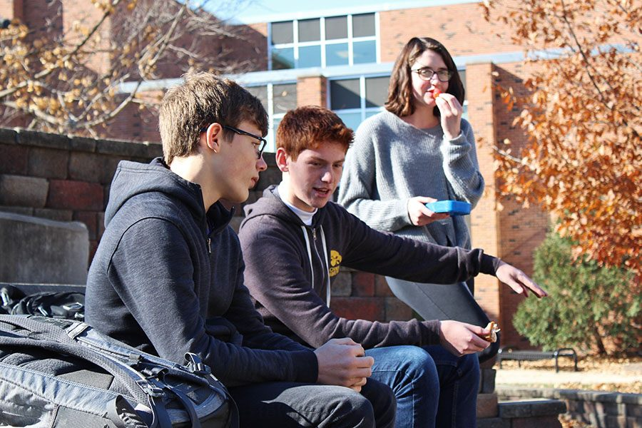 Tony Abdel Malek '22 talks to Liam Edberg '22 and Claire Loussaert '22 about how they plan to beat last year's record of eating outside during lunch on Wednesday, Nov. 14.