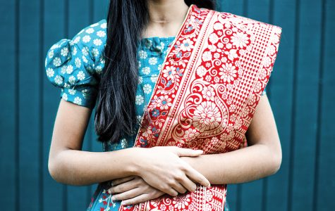 Shreya Khullar '22 holds her dupatta, an Indian accessory, in place while posing in a lehenga, a traditional Indian dress.