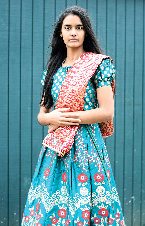 Shreya Khullar '22 wears a traditional Indian lehenga. Lehengas often consist of a colorful blouse and matching skirt paired with a scarf of a complementary color, called a dupatta.