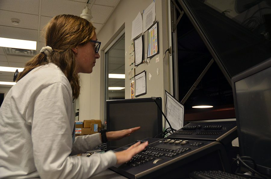 Stage manager Emily Hill '20 looks out on to the stage from the lights booth.