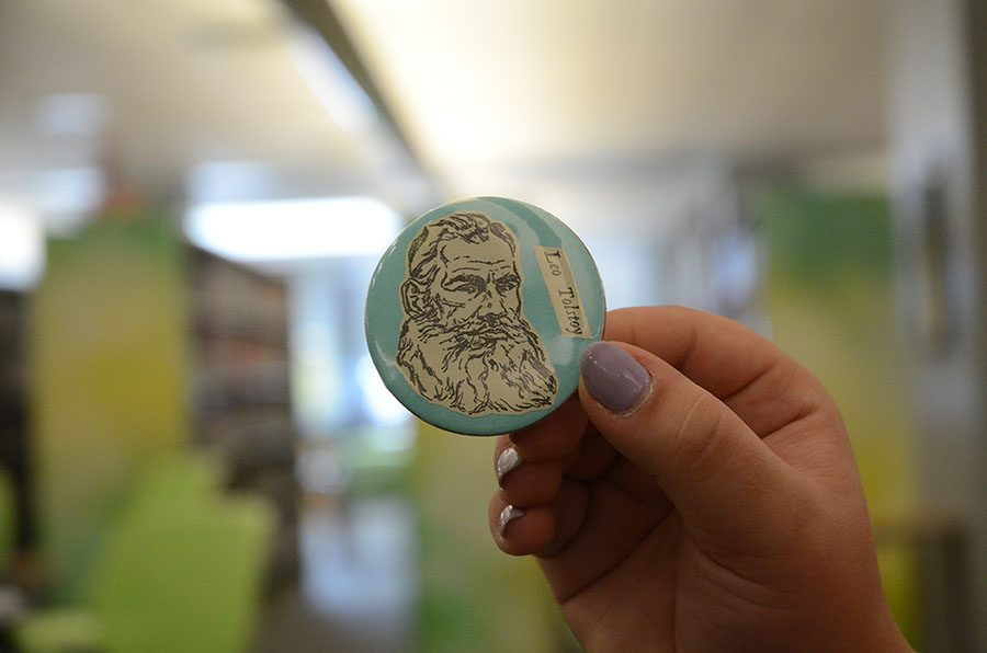 Buttons can be made from photos, colored paper, or cut outs from books that are ready to be recycled.