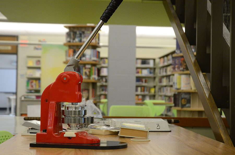The button maker arrived in September and is located in the library.