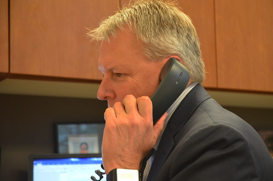 Dr. Shoultz makes a phone call during the middle off the day.
