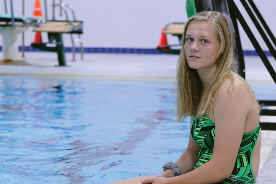 Lily Ernst '20 sits on the edge of the pool for a photo on Monday, Sept. 10.