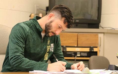 Nate Frese works on grading papers during his second hour open on Friday, Dec. 14.