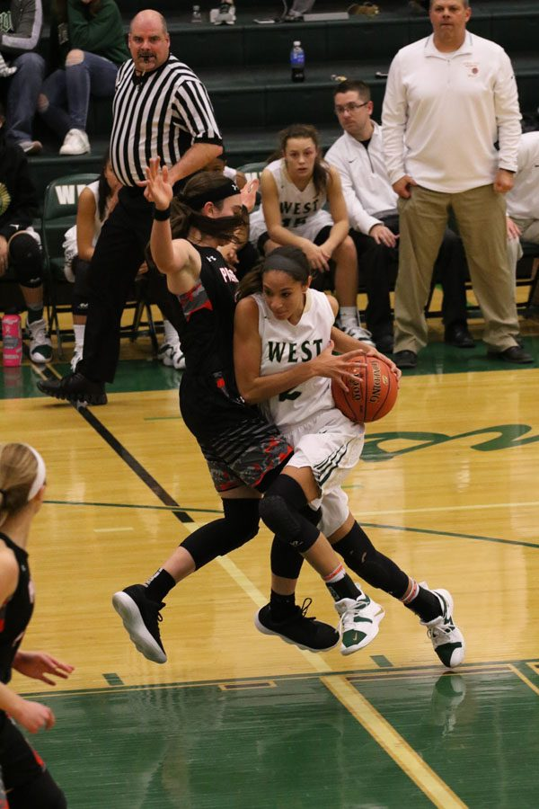 Cailyn+Morgan+%2719+drives+towards+the+basket+for+a+layup+during+the+second+half+on+Friday%2C+Nov.+30.