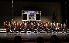 West's varsity show choir, Good Time Company, sits on the risers during their jukebox-themed show.