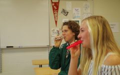 Kaisa Whittaker '21 and Katie Hoefer '21 kick off a kazoo club meeting on December 4 with some helpful breathing exercises.