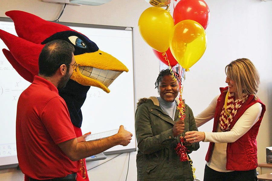 Iowa State University representatives surprise Veronica Kharunda '19 in her pre-calculus class with the news of her acceptance to the university on Monday, Nov. 19.