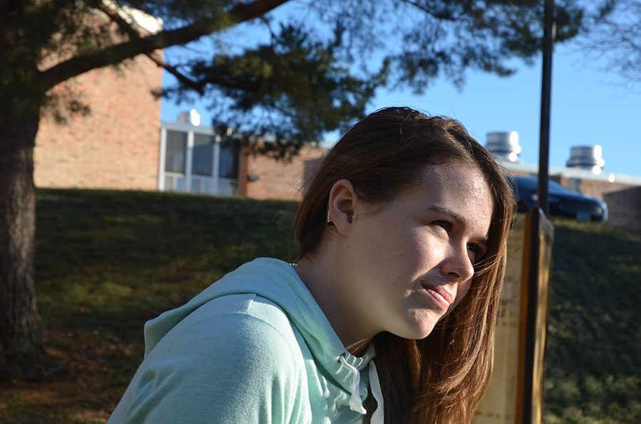Mia Dillingham '20 poses for a photo in the courtyard on Dec 5.
