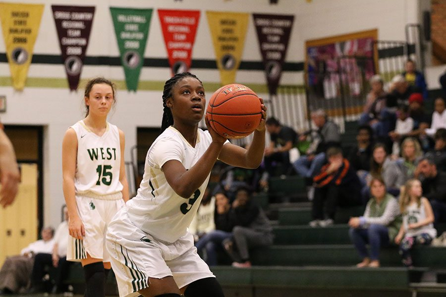 Matayia Tellis '21 stands at the free throw line as she adds two more points to West's score during the second half on Friday, Jan. 4.