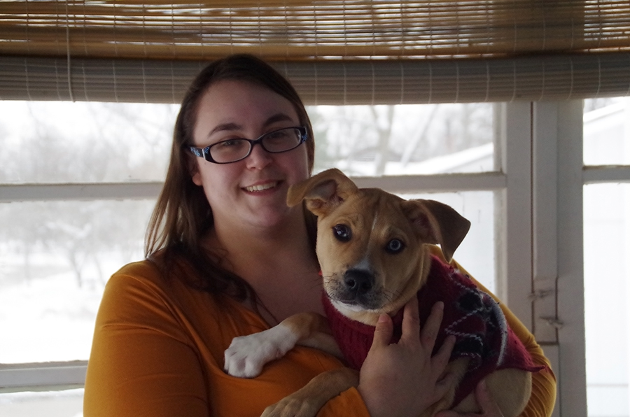 Jennifer Craig and Dante the dog pose for a photo on Sunday, Jan 13. at their new house, bought on Saturday, Jan 12.