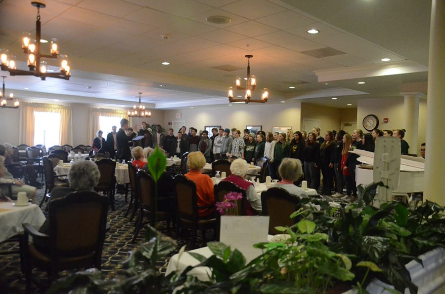 Choir students gathered at the Melrose Meadows retirement home to sing and bring joy to the senior residents.