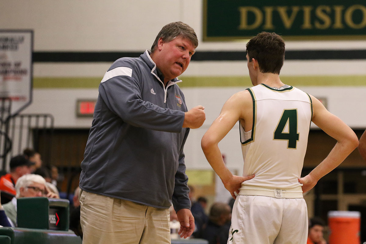 Head coach Steve Bergman talks to Brayden Adcock '19 during the second half on Tuesday, Jan. 15.