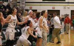 The girls basketball team cheers after Lauren Zacharias '19 scored the game-winning shot against Prairie on Friday, Nov. 30.