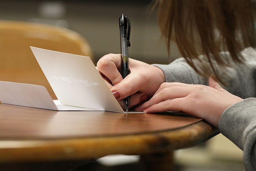 Sophie Stephens '19 poses as she writes a letter on Wednesday, Feb. 13.