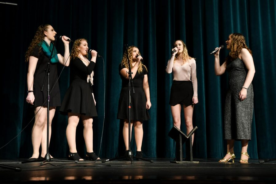Seniors Carrie Harper, Marijke Nielsen, Hanna O'Dell, Maggie McGlaughlin and Lucy Polyak perform
