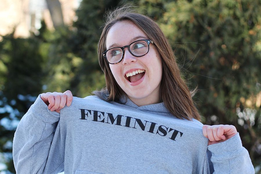 Photo Editor Maddi Shinall '19 poses for a photo as she displays her feminist slogan sweatshirt on Friday, Feb. 15.