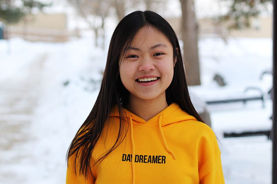 Editorials Editor Jenna Wang '20 smiles for a portrait in the West High courtyard.