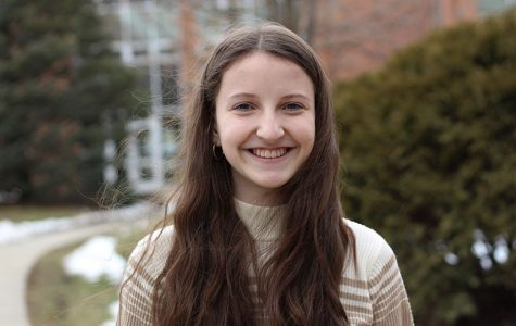 Guest columnist Sumner Wallace '20 smiles for a portrait in the West High courtyard. She writes about the need for communication in her piece.