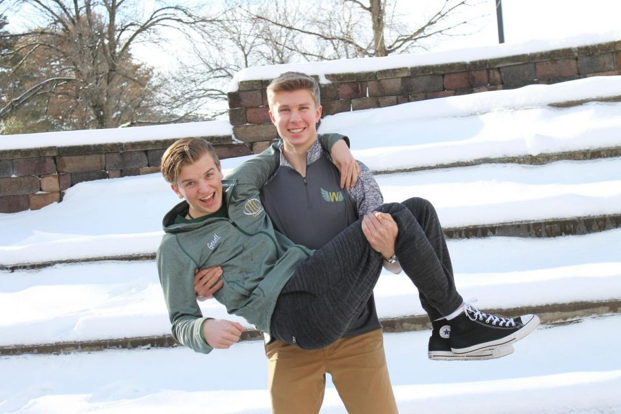 Eric Doorn '19 holds Dylan  Gesell '19 in the courtyard on Valentine's Day.