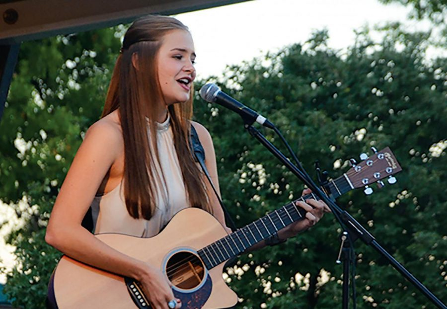 Abbie Callahan '20 performs at the Johnson County Fair talent show in July 2018, placing first and advancing to the Iowa State Fair talent show.