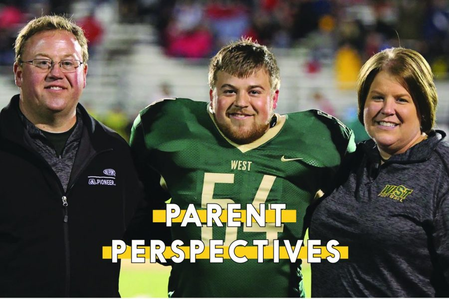 Alex Boxwell '19 stands with his parents Denise and Brian during the West varsity football senior night on Friday, Oct. 19.