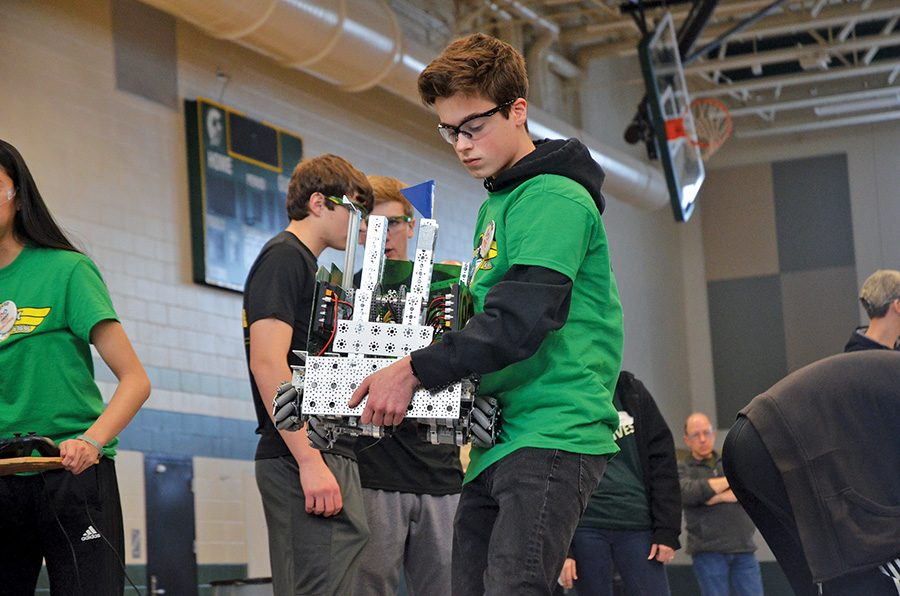 Ivan Badovinac '19 carries the robot off the field during the qualifying matches of the Super Qualifiers on February 9.