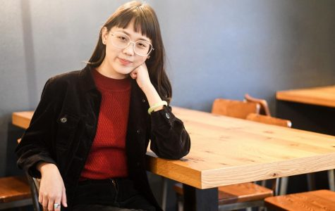 Shirley Wang poses for a photo at Java House. The 22-year-old was the creator of a viral podcast that detailed her father's friendship with former NBA superstar Charles Barkley.