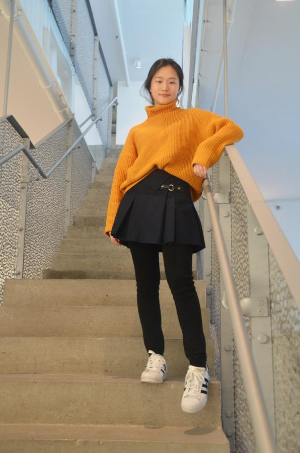 %22I+would+say+black+matches+almost+every+color.+And+the+yellow+sweater+is+pretty+plain%2C+so+the+bow+on+the+skirt+%5Bgave%5D+some+detail+to+it.%22+-Eliana+Cheng+%2719