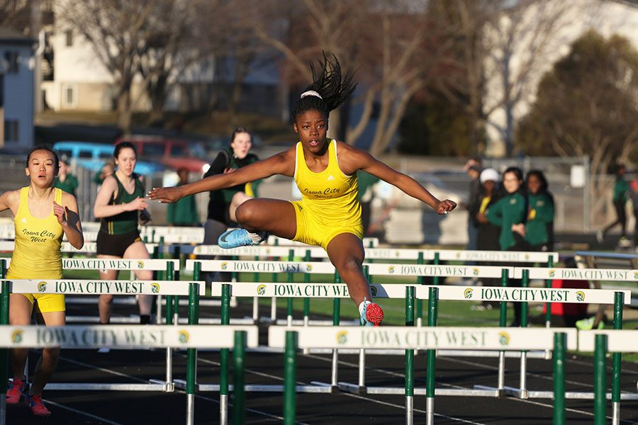 Matayia Tellis '21 sprints down the track during the JV 100 meter hurdle race on Tuesday, March 26.