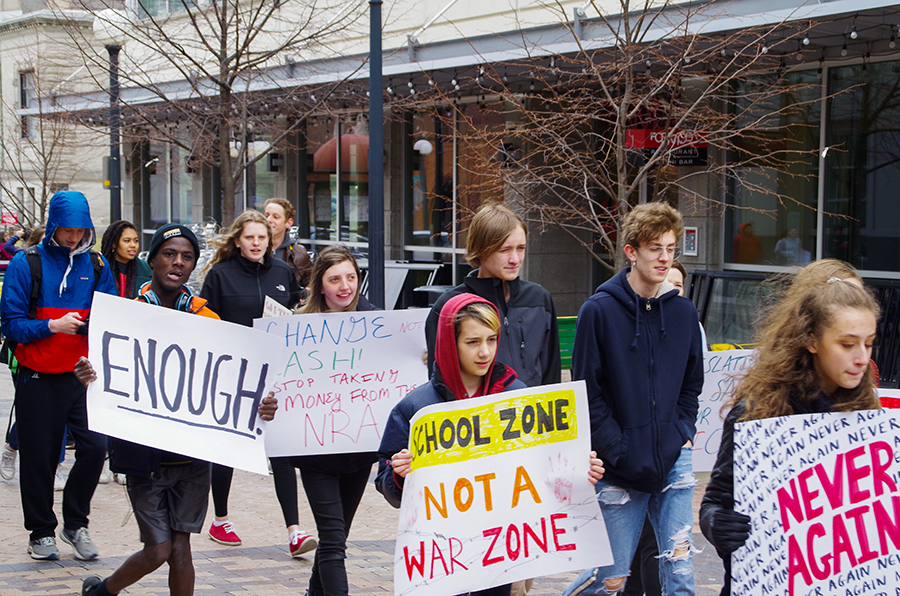 Students from all around the district march from College Green park to the Pentacrest in the second annual March for Our Lives on Saturday, March 30.