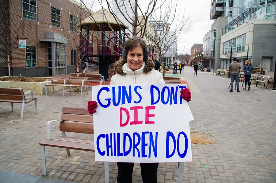 Local resident, Lonni Parrot, shows her support for the victims of gun violence.