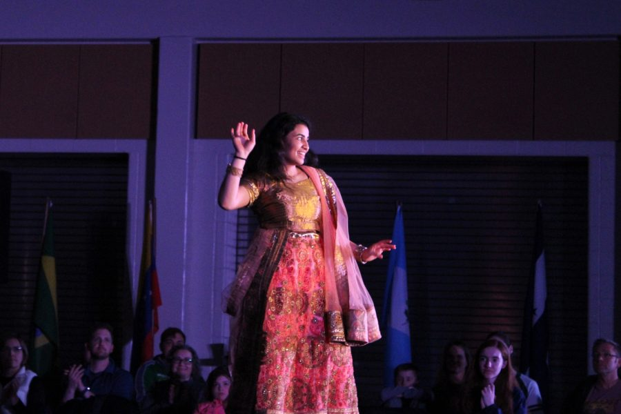 Aditi Borde '21 dances as she models on stage during the South Asian group's section of Walk it Out on Saturday, March 9.