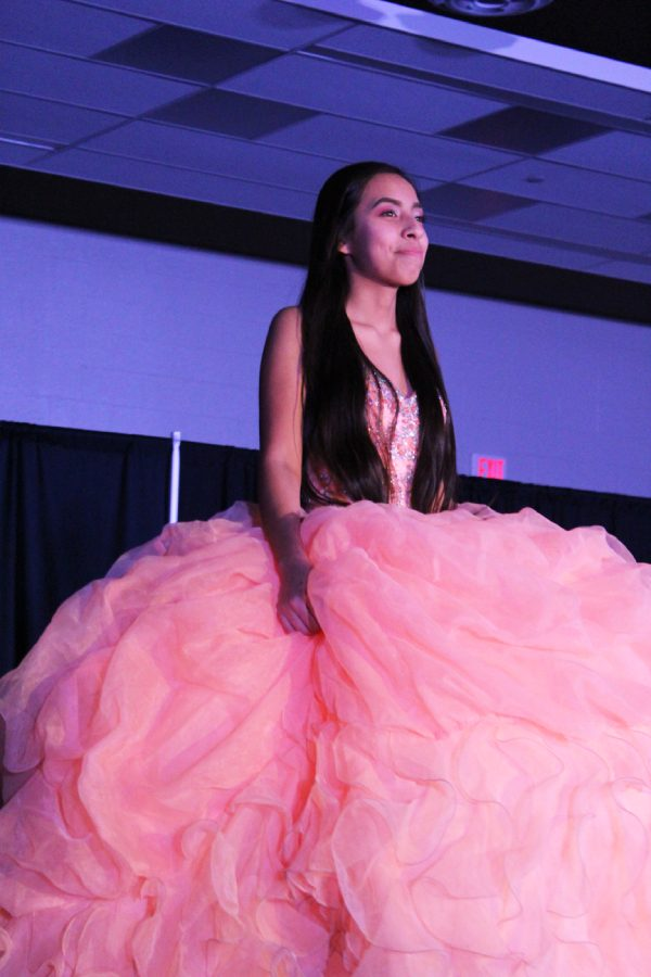 Melissa Diaz '21 walks the runway in a quinceañera dress during the Latin American section of the show on Saturday, March 9. This year, the group decided they wanted to show off quinceañera dresses in addition to other traditional Latinx clothing.