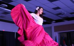 Mayela Pelayo 18 spins on stage to show her skirt as she models during the Latin American section of the show on Saturday, March 9.