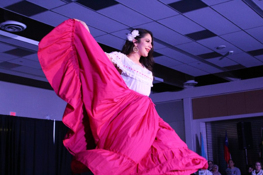 Mayela Pelayo '18 spins on stage to show her skirt as she models during the Latin American section of the show on Saturday, March 9.