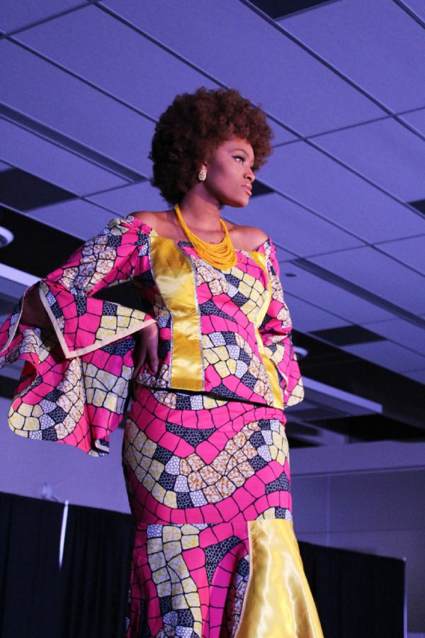 Ahjiana Walker Garcia '20 poses at the end of the runway during the African group's section of the show on Saturday, March 9.