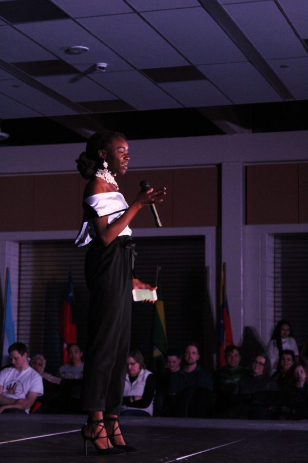 Prisca Namutchibwe '20 performs her original poem as a special act during Walk it Out on Saturday, March 9. In the poem, she asks white parents to tell their children about all of Africa, not just the bad. Her poem also discusses her learning about European culture and history before her own in school.