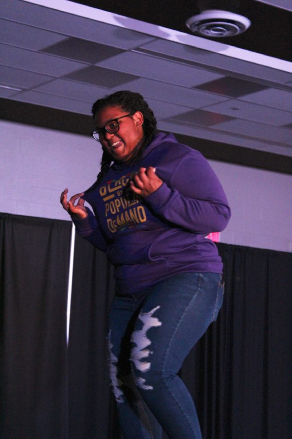 Dasia Taylor '20 dances down the runway during the black American group's section of the show on Saturday, March 9. She gave high fives to audience members in the front row as she made her way across the stage.