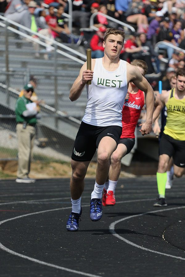 Cole Mabry 19 competes in the 4x400 meter relay race, the last event of the meet on Saturday, April 6. Mabry ran the third leg and the relay team placed ninth in a time of 3:35.12. He also competed in the distance medley which placed fourth in a time of 3:45.83, the 400 meter hurdles where he placed fifth in 58.03 and the 4x200 meter relay which placed ninth in a time of 1:34.80.