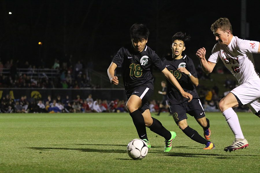 Andy Lu 21 watches the ball go down the field as he tries to defend it during the second half on Tuesday, April 9.