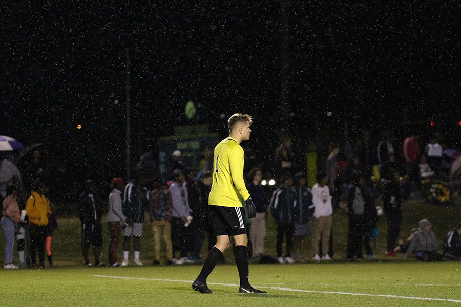 Zach Albright 19 watches the game unfold as rain sprinkles down during the second half on Tuesday, April 9.