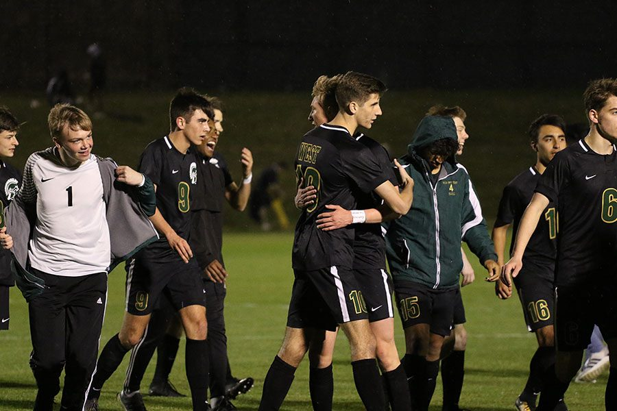 Josh Jasek 19 and Matthew McDonnell 19 embrace after their 1-0 win against City on Tuesday, April 9.
