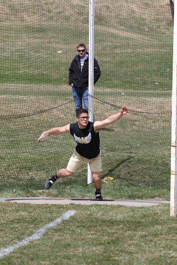 Landon Green competes in the discus on Saturday, April 13. Green won the shot put with a throw of 53-02.50
