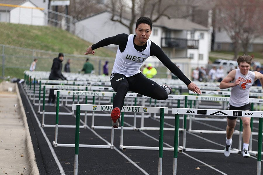 Chris Caruthers 20 jumps over the last hurdle to finish the shuttle hurdle relay. West placed second in 1:09.70.
